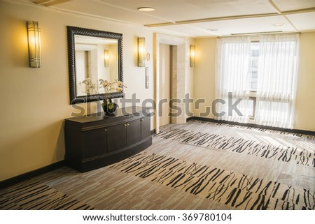 Stylish hallway in modern residence with rich furniture and carpet. - stock photo