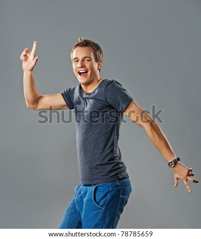 Stylish handsome young man dancing - stock photo