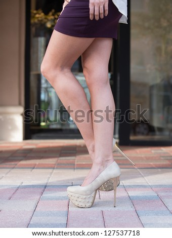 Stylish high heel shoes in motion.