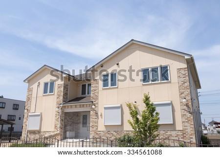 Stylish house of detached houses image tiles tone siding - stock photo