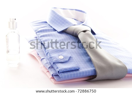 Stylish image of two formal men's shirts with a bottle of scent - stock photo