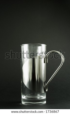 Stylish Irish coffee glass made in Denmark.   Isolated on matte black background.