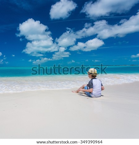 Stylish kid relaxing on the tropical beach in Cayo Largo island