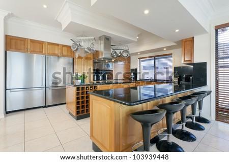 Stylish kitchen in luxurious house - stock photo