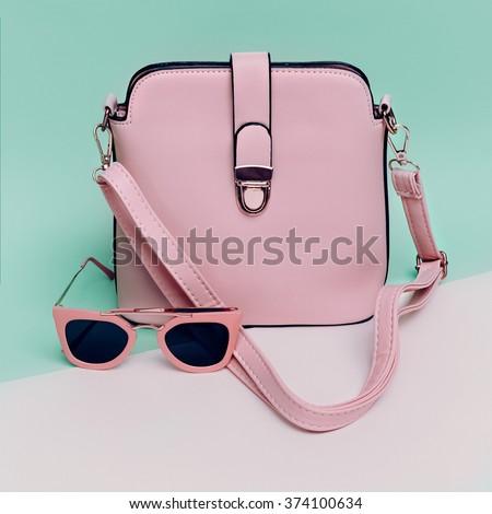 Stylish Ladies Accessories. Sunglasses & Handbag. Focus on Pastel Colors. - stock photo