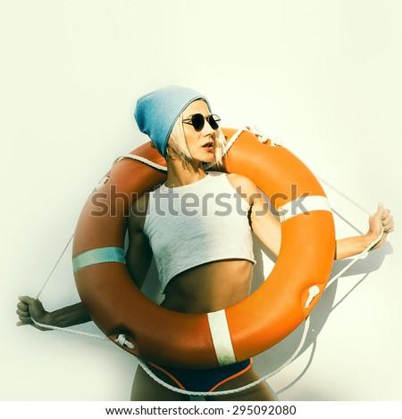 Stylish Lady with Life buoy. Fashion Maritime style - stock photo