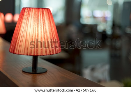 Stylish lamp in colorfull restaurant with bokeh background - stock photo