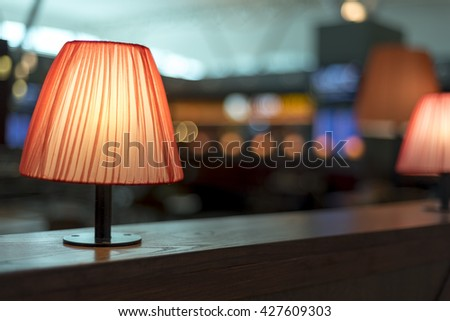 Stylish lamp in colorfull restaurant with bokeh background