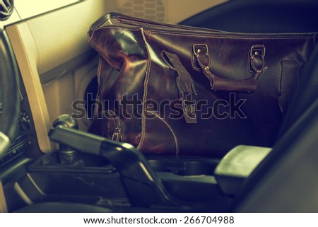 stylish leather bag inside the car