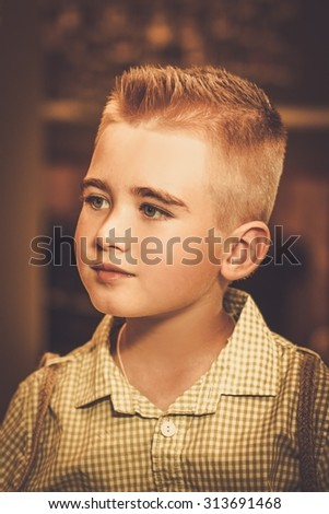 Stylish little boy in a barber shop - stock photo