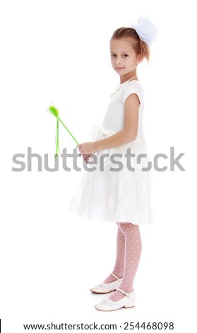 Stylish little girl with a magic wand. Isolated on white.