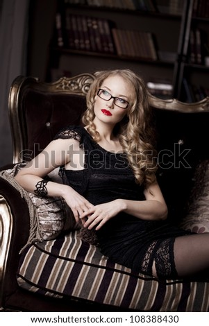 Stylish luxury businesswoman in glasses - stock photo