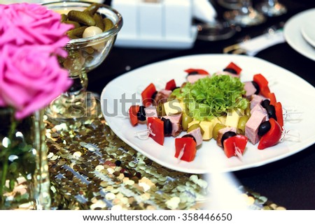 stylish luxury decorated tables with appetizer for birthday celebration, cathering in the restaurant