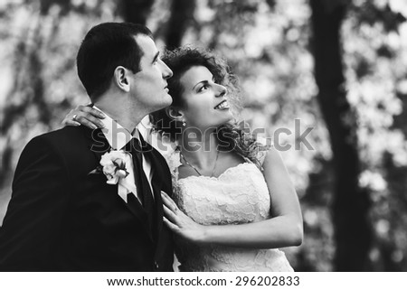 stylish luxury red haired bride and elegant groom, hugging in the autumn park, on the background of the old city Lviv