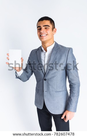 Stylish male showing blank white card, man on white background in Studio