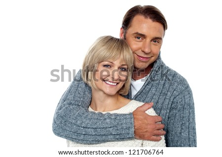 Stylish man embracing his wife from behind. Couple in love. - stock photo