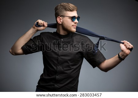 Stylish man in black shirt and mirrored sunglasses