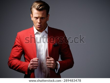 Stylish man in red jacket   - stock photo