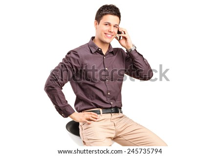 Stylish man talking on a cell phone isolated against white background - stock photo
