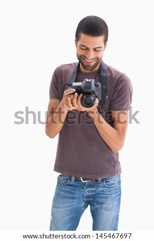 Stylish man with camera around his neck on white background