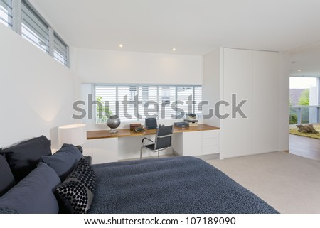 Stylish master bedroom with workspace in luxury Australian mansion - stock photo