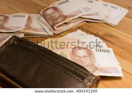 Wonderful Stylish Menu0027s Purse With Money On Wood Background