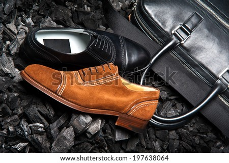 Stylish men's shoes on the coals - stock photo