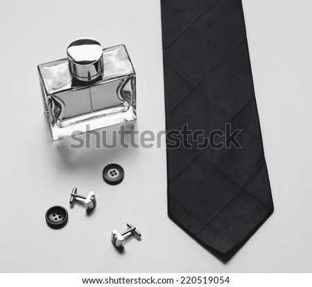 Stylish mens business accessories tie cologne cuff links - stock photo