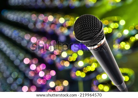 Stylish microphone over on bokeh blurred background - stock photo