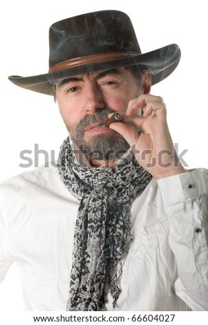 Stylish middle aged man with a smoking cigar.