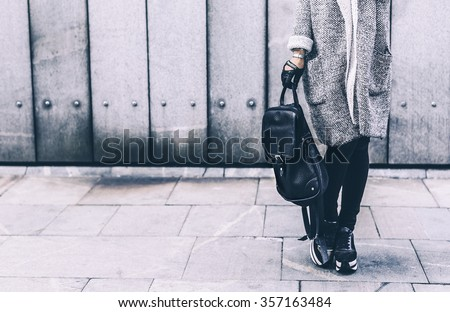 Stylish Model in a fashionable Clothes and Accessories on the Street Location - stock photo