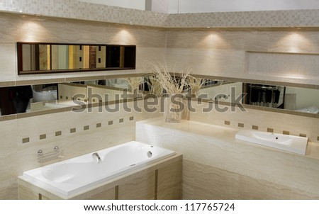 Stylish modern bathroom with bath shower, sink and toilet - stock photo