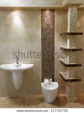 Stylish modern bathroom with shower, sink and toilet - stock photo