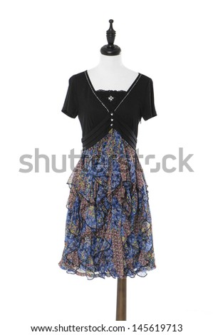 Stylish, modern dress on mannequin on white background