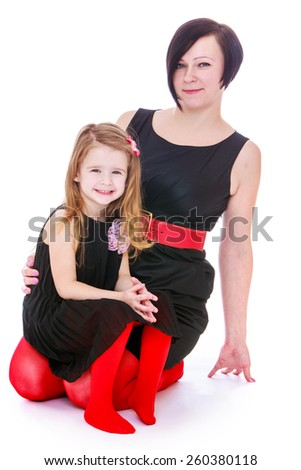 stylish mother and daughter, studio shooting - isolated on white. - stock photo