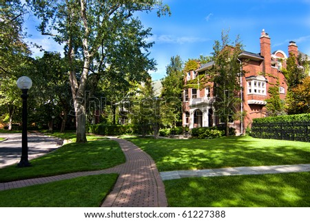 Stylish neighborhood depicting executive style houses and well maintained landscapes. - stock photo