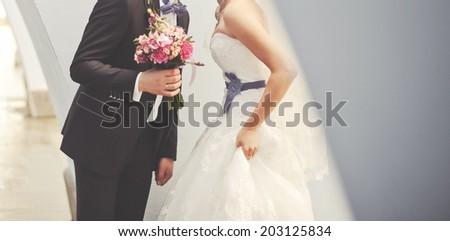 Stylish newlywed caucasian couple together. Wedding day. - stock photo