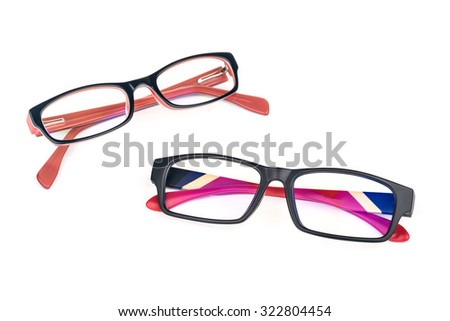 Stylish pair of men and women eye glasses in folded state over white - stock photo