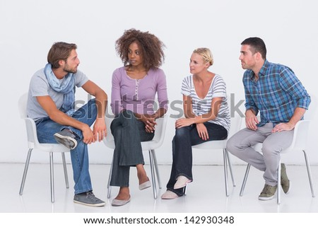 Stylish people sitting and chattingpeople  on white background - stock photo