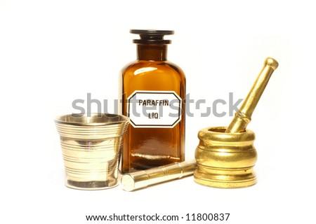 Stylish pharmacy bottle and mortars, isolated - stock photo