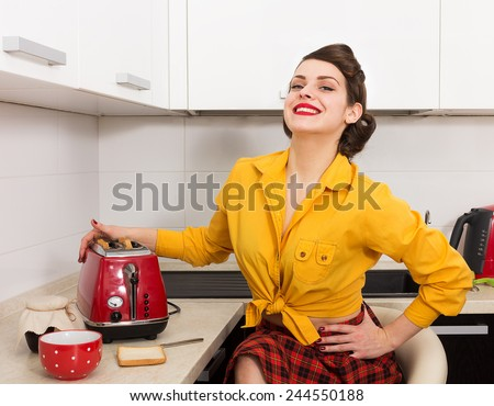 Stylish pin up housewife in her kitchen
