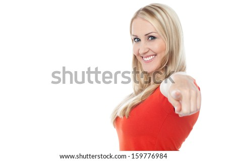 Stylish portrait of a woman pointing you out - stock photo