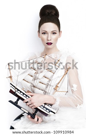 stylish portrait yong women in studio whith ship - stock photo