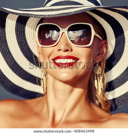 Stylish pretty woman wearing hat and sunglasses - stock photo
