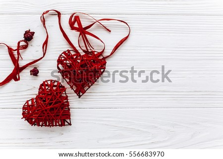 stylish red hearts flat lay on white wooden background. happy valentines day concept. greeting card with space for text. wedding or birthday  accessories