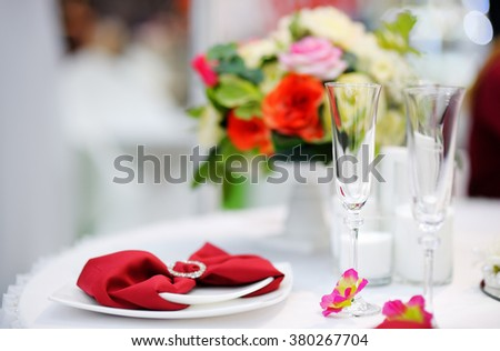 Stylish red table set with natural flowers