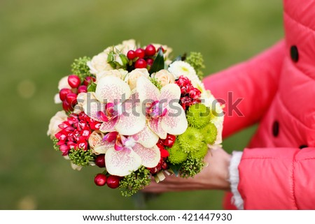 Stylish rich bouquet with red berries - stock photo
