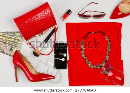 Stylish set of red clothing and accessories for girl. - stock photo