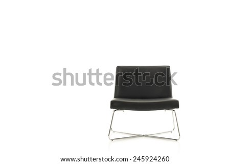 Stylish simple contemporary black chair with crossed metal legs isolated on white, frontal view with copyspace - stock photo