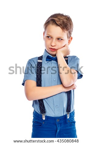Stylish small boy in glasses looks unpleased and upset. Isolated on a white background. - stock photo